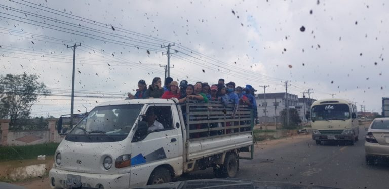 A group of people in the back of a truck