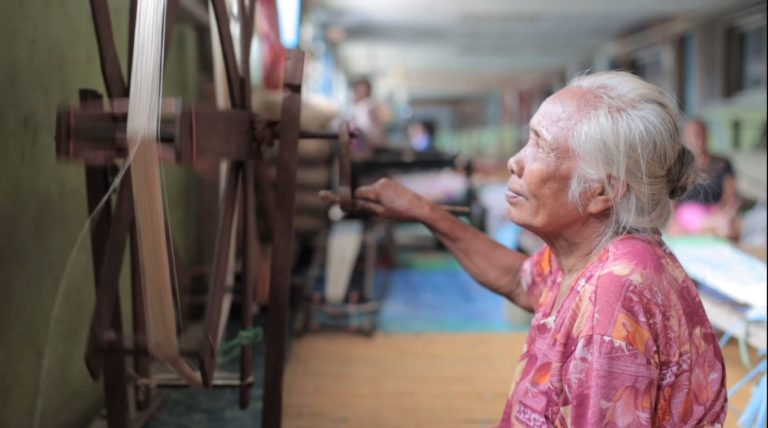 A weaver doing her job in the Longhouse of Rumah Malaysian Station where the Social and Solidarity Economy is established